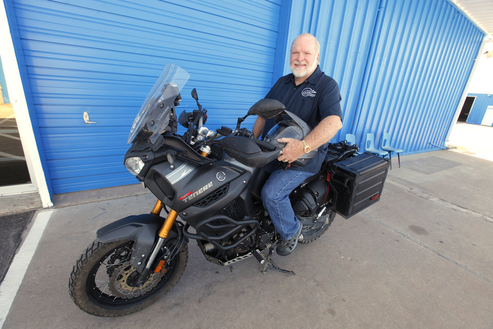 Photo -  Dan Maxey with the Yamaha Super Tenere motorcycle he rode to Alaska outside his shop in Oklahoma City on Tuesday. Photo by Paul B. Southerland, The Oklahoman   PAUL B. SOUTHERLAND -  PAUL B. SOUTHERLAND