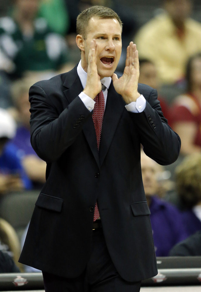 Photo - Iowa State head coach Fred Hoiberg yells to his team during the first half of an NCAA college basketball game agaisnt Kansas State in the quarterfinals of the Big 12 Conference men's tournament  in Kansas City, Mo., Thursday, March 13, 2014. (AP Photo/Orlin Wagner)