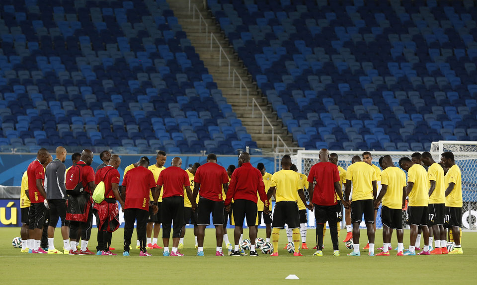 Photo - Ghana players gather on the pitch during an official training session the day before the group G World Cup soccer match between Ghana and the United States at the Arena das Dunas in Natal, Brazil, Sunday, June 15, 2014. (AP Photo/Dolores Ochoa)
