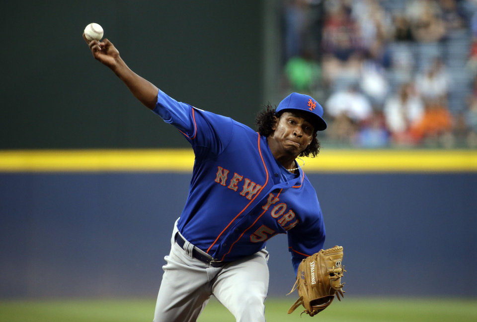 Photo - New York Mets starting pitcher Jenrry Mejia throws in the first inning of a baseball game against the Atlanta Braves, Thursday, April 10, 2014, in Atlanta. (AP Photo/David Goldman)
