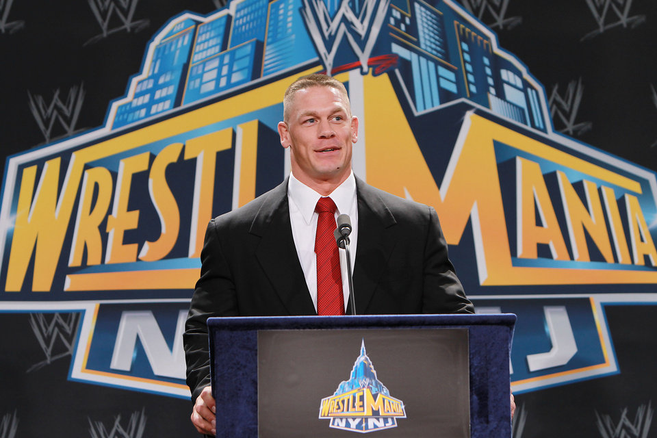 "In this Thursday, Feb. 16, 2012 photo, World Wrestling Entertainment personality John Cena speaks at a news conference in East Rutherford, N.J., to announce that MetLife Stadium will host WrestleMania XXIX on April 7, 2013. WWE is joining with New York Mayor Michael Bloomberg, New Jersey Gov. Chris Christie, Hollywood celebrities and professional athletes to launch Superstars for Sandy Relief. Fans can bid on hundreds of items in an online auction, including attending a NASCAR race with Cena, meeting Tyra Banks on the set of ""America\'s Next Top Model,"" or pitching entrepreneurial ideas to Mark Cuban. The auction begins Monday, March 25, 2013, and closes April 9 on charitybuzz.com. (AP Photo/StarPix, Dave Allocca)"