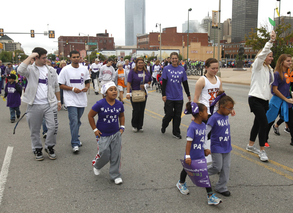 Walkers near the finish line during the 2012 Oklahoma City Walk to End Alzheimer\'s at Bricktown Ballpark in Oklahoma City, OK, Saturday, September 15, 2012, By Paul Hellstern, The Oklahoman