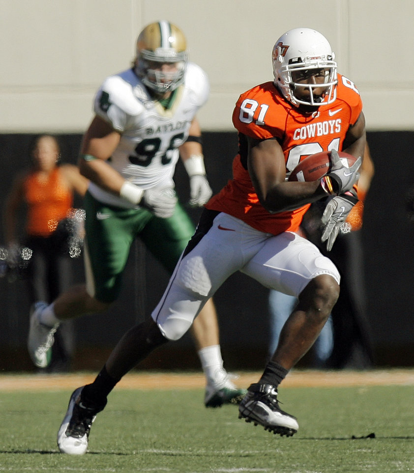 OSU\'s Justin Blackmon (81) runs after a catch in the fourth quarter during the college football game between the Oklahoma State University Cowboys (OSU) and the Baylor University Bears at Boone Pickens Stadium in Stillwater, Okla., Saturday, Nov. 6, 2010. OSU won, 55-28. Photo by Nate Billings, The Oklahoman