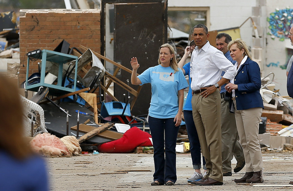 President Barack Obama walks with Plaza Towers Elementary Principal Amy Simpson thorough the school in Moore, Okla., Sunday, May 26, 2013. President Obama toured the area in Moore that was hit by a tornado on May, 20, 2013. Photo by Bryan Terry, The Oklahoman ORG XMIT: OKC1305261411038212