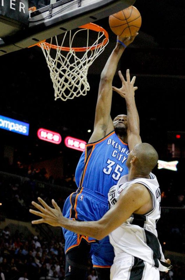 Oklahoma City's Kevin Durant (35) can't get past San Antonio's Tim Duncan (21) during Game 1 of the Western Conference Finals between the Oklahoma City Thunder and the San Antonio Spurs in the NBA playoffs at the AT&T Center in San Antonio, Texas, Sunday, May 27, 2012. Oklahoma City lost 101-98. Photo by Bryan Terry, The Oklahoman