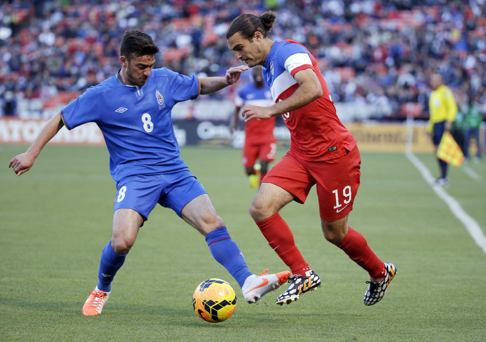 Photo - United States' Graham Zusi, right, goes for the ball against Azerbaijan's Gara Garayev during the first half of an international friendly soccer match on Tuesday, May 27, 2014, in San Francisco. (AP Photo/Marcio Jose Sanchez)