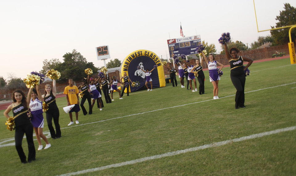 Pep squads await the team at the Northwest Classen vs. Western Heights high school football game at Taft Stadium Thursday, September 20, 2012. Photo by Doug Hoke, The Oklahoman