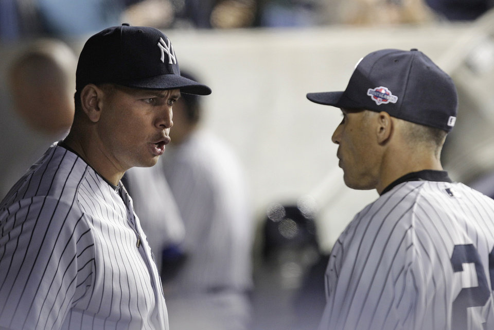 New York Yankees' Alex Rodriguez, left, talks to manager Joe Girardi during the 10th inning of Game 3 against the Baltimore Orioles in the American League division baseball series Wednesday, Oct. 10, 2012, in New York. The Yankees won 3-2. (AP Photo/Kathy Willens)
