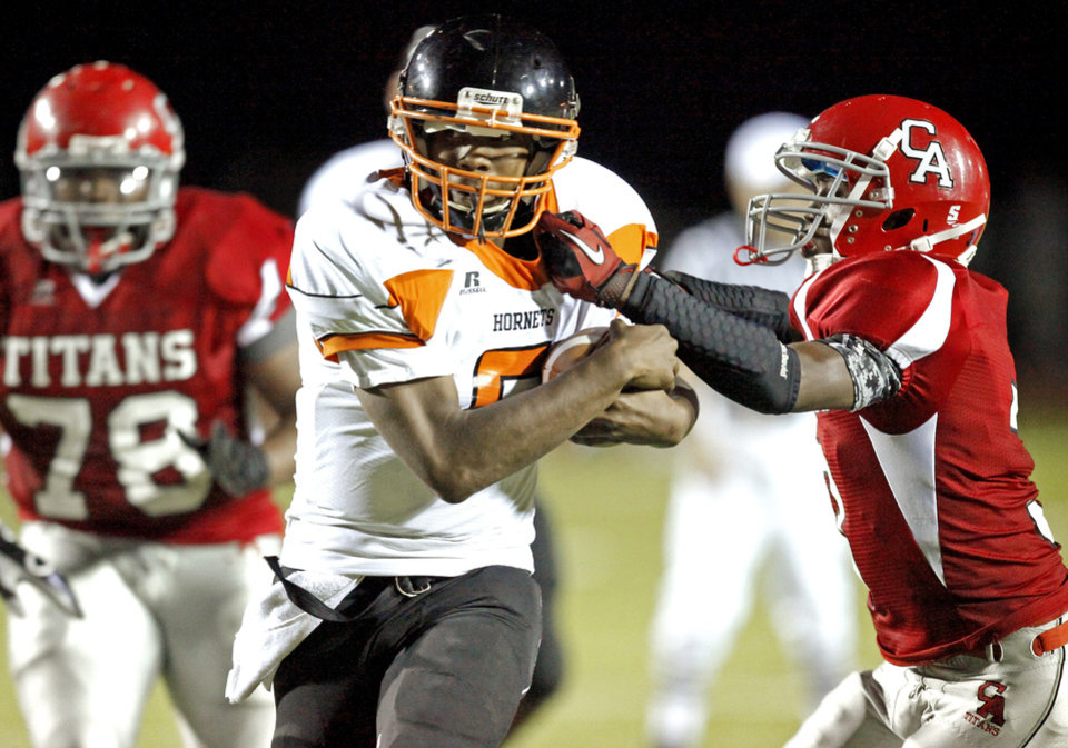 Photo - Dominique Sells of Booker T. Washington gets past Carl Albert's Darrain Winston to score a touchdown during a high school football game in Midwest City, Okla., Friday, September 3, 2010.  Photo by Bryan Terry, The Oklahoman