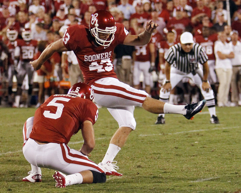 Photo - Oklahoma's Patrick O'Hara (43) kicks a field goal during the second half of the college football game between the University of Oklahoma Sooners (OU) and Utah State University Aggies (USU) at the Gaylord Family-Oklahoma Memorial Stadium on Saturday, Sept. 4, 2010, in Norman, Okla.   Photo by Chris Landsberger, The Oklahoman