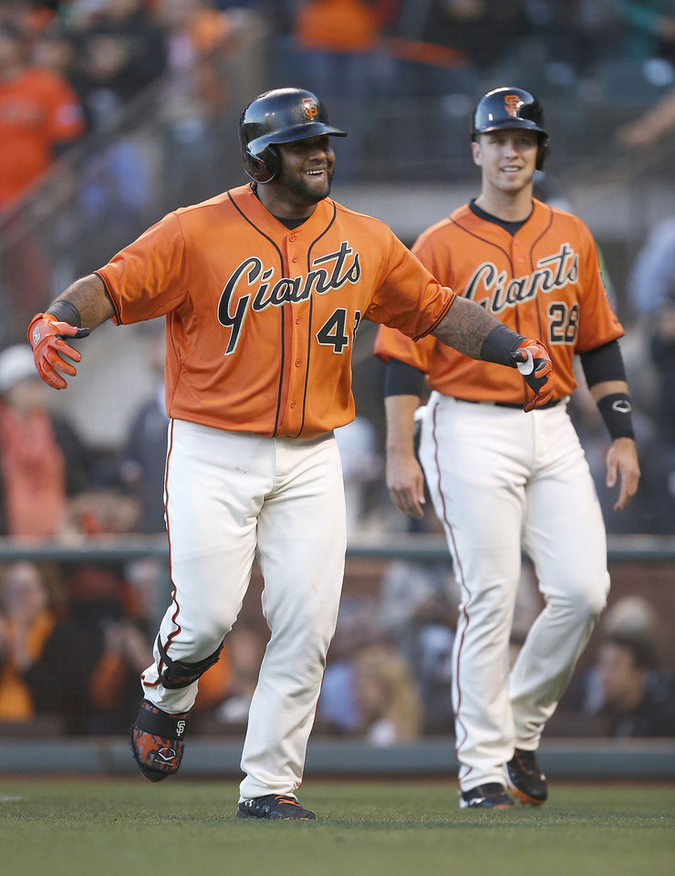 Photo - San Francisco Giants' Pablo Sandoval (48) celebrates with Buster Posey (28) after hitting a three-run home run off Minnesota Twins starting pitcher Kyle Gibson in the first inning of a baseball game Friday, May 23, 2014, in San Francisco. (AP Photo/Tony Avelar)