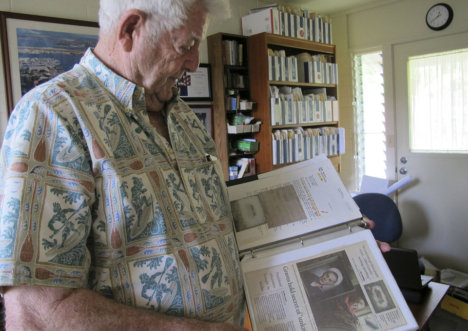 Photo - Ray Emory discusses his work pushing to change grave markers for unknown Pearl Harbor dead and identifying the remains of unknowns at his home in Honolulu on Nov. 21, 2012. The Navy and National Park Service will honor Emory on Dec. 7 for his determination to have Pearl Harbor remembered, and remembered accurately.(AP Photo/Audrey McAvoy)