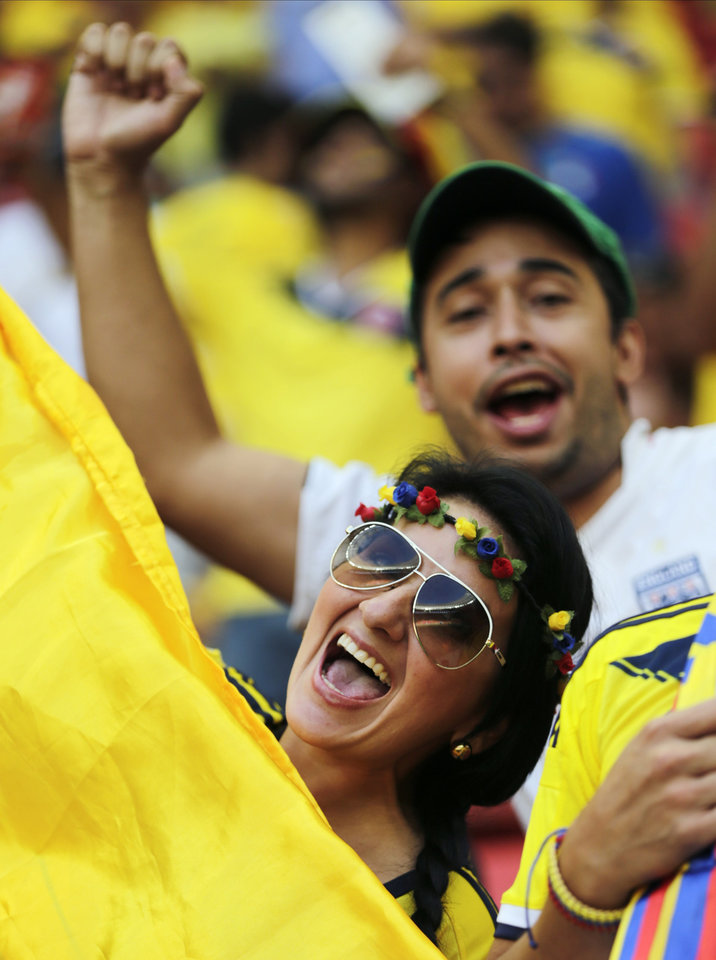 Photo - Columbian fans cheer before the start of the group C World Cup soccer match between Colombia and Ivory Coast at the Estadio Nacional in Brasilia, Brazil, Thursday, June 19, 2014.  (AP Photo/Fernando Llano)