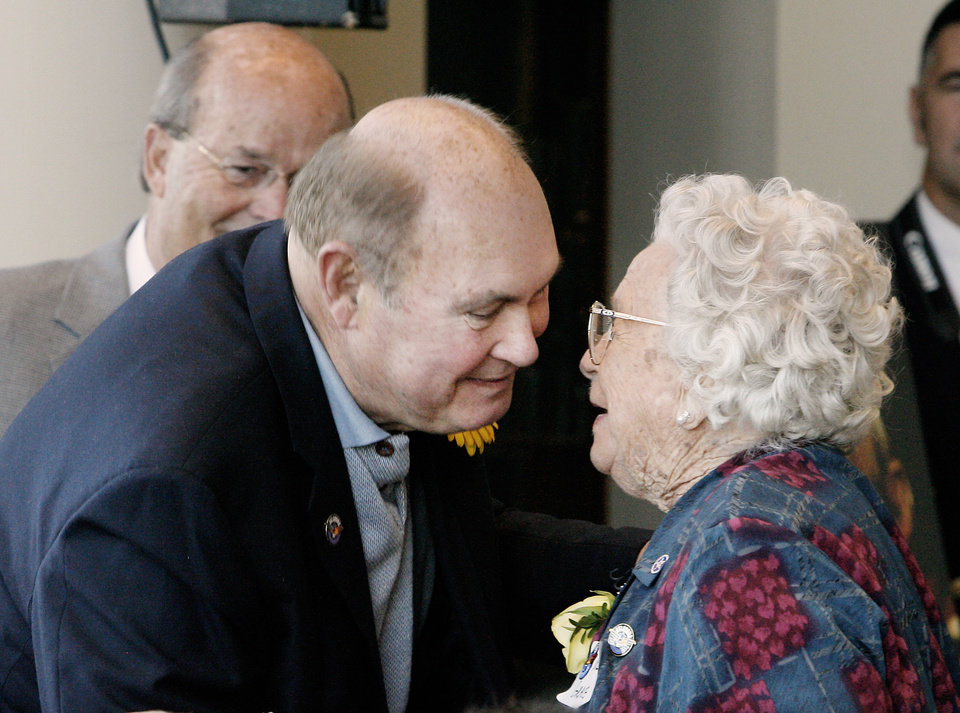 Photo - Willard Scott receives a kiss from Grace Garoutte, Afton, 102, while attending the Centenarian Celebration held at the Oklahoma History Center during Oklahoma Statehood Day in Oklahoma City Friday, Nov. 16, 2007. By Paul B. Southerland, The Oklahoman