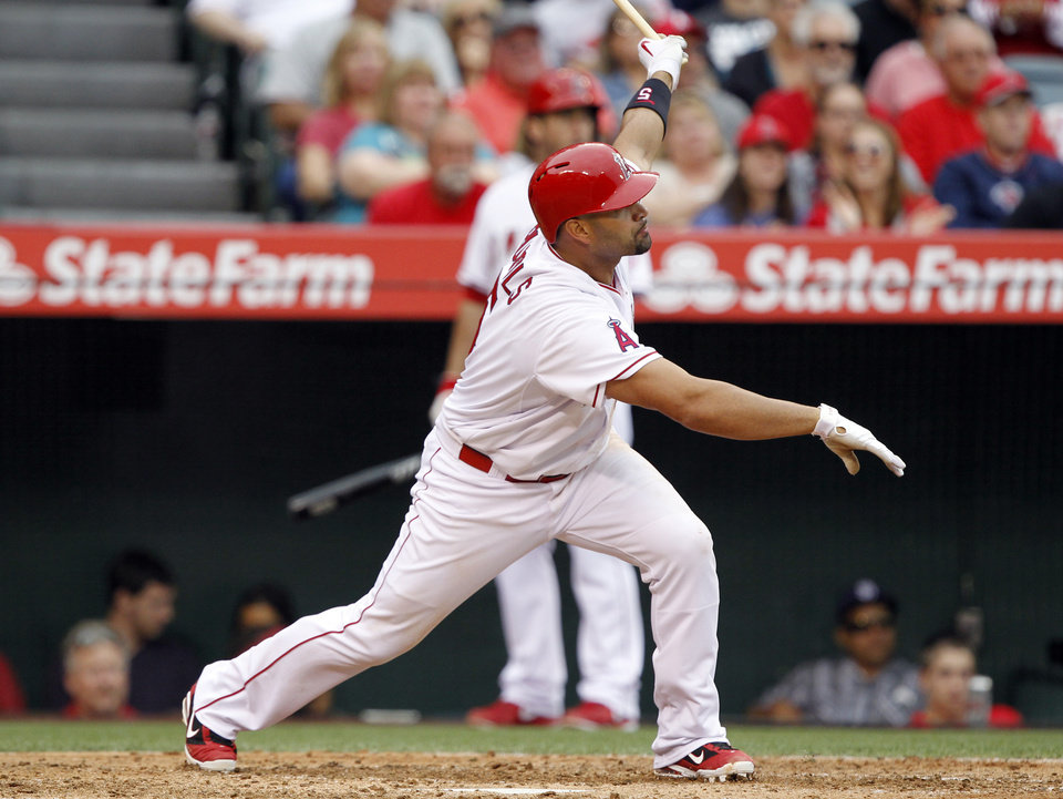 Photo - Los Angeles Angels' Albert Pujols watches his double against the Kansas City Royals in the fifth inning of a baseball game Saturday, May 24, 2014, in Anaheim, Calif. Pujol's double is the 2,400th hit of his career. (AP Photo/Alex Gallardo)