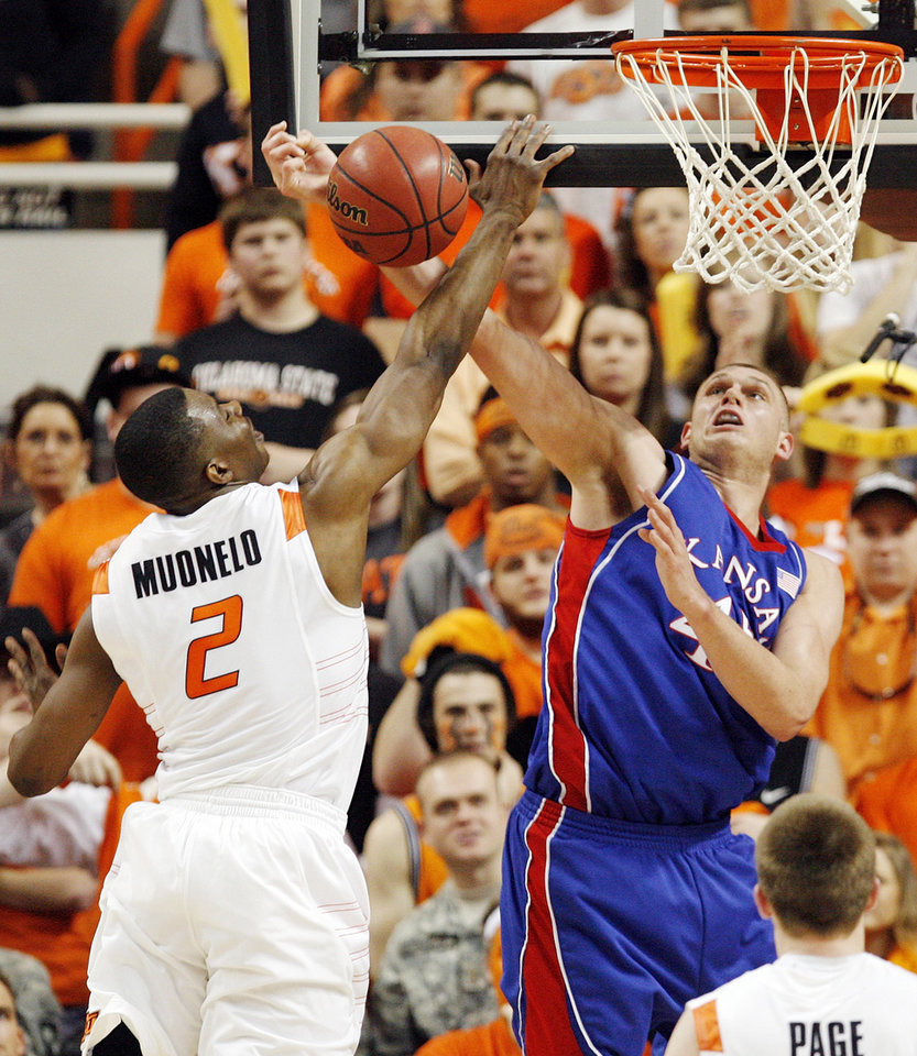 OSU's Obi Muonelo (2) defends a shot by Cole Aldrich (45) of KU in the first half during the men's college basketball game between the University of Kansas (KU) and Oklahoma State University (OSU) at Gallagher-Iba Arena in Stillwater, Okla., Saturday, Feb. 27, 2010. Photo by Nate Billings, The Oklahoman