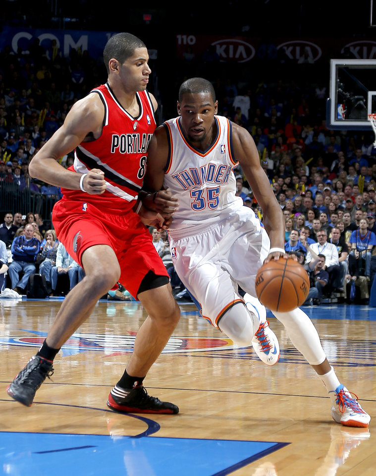 Photo - Oklahoma City's Kevin Durant (35) drives past Portland's Nicolas Batum (88) during the NBA basketball game between the Oklahoma City Thunder and the Portland Trail Blazers at the Chesapeake Energy Arena in Oklahoma City, Sunday, March, 24, 2013. Photo by Sarah Phipps, The Oklahoman