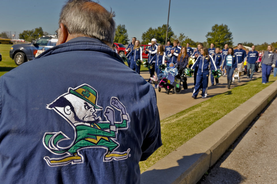 "A Notre Dame fans looks on as the ""Band of The Fighting Irish,"" along with the spirit squads and mascot put on a special performance for the patients and employees of The Children's Center on Friday, Oct. 26, 2012, in Bethany, Okla. Photo by Chris Landsberger, The Oklahoman"