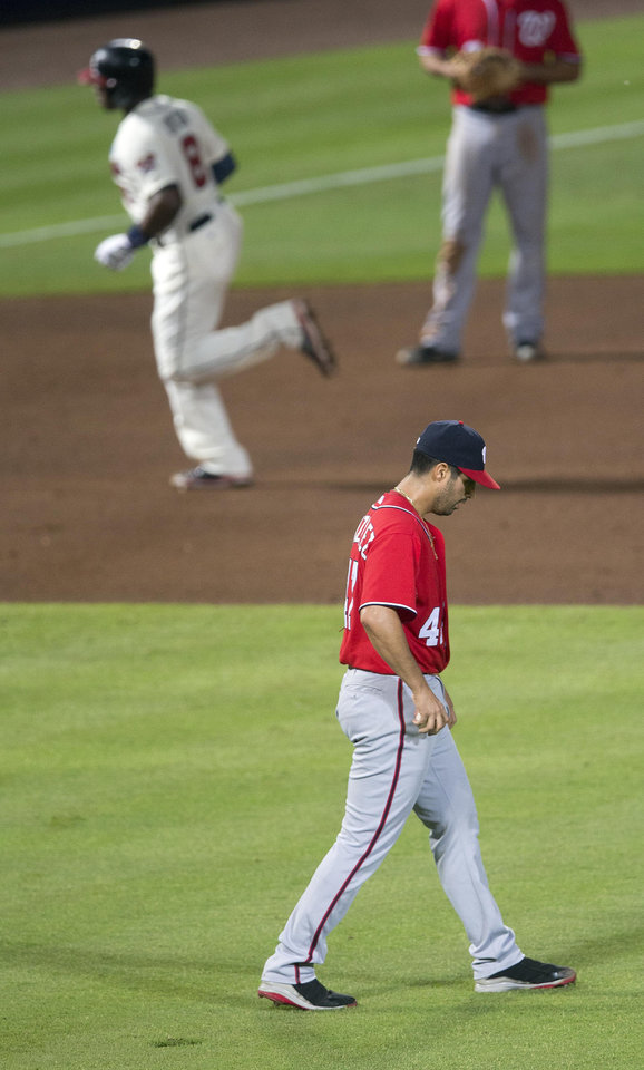 Photo - Washington Nationals starting pitcher Gio Gonzalez (47) walks back to the mound as Atlanta Braves left fielder Justin Upton (8) rounds the bases after hitting a solo-home run in the fourth inning of a baseball game  Sunday, Aug. 10, 2014 in Atlanta. (AP Photo/John Bazemore)