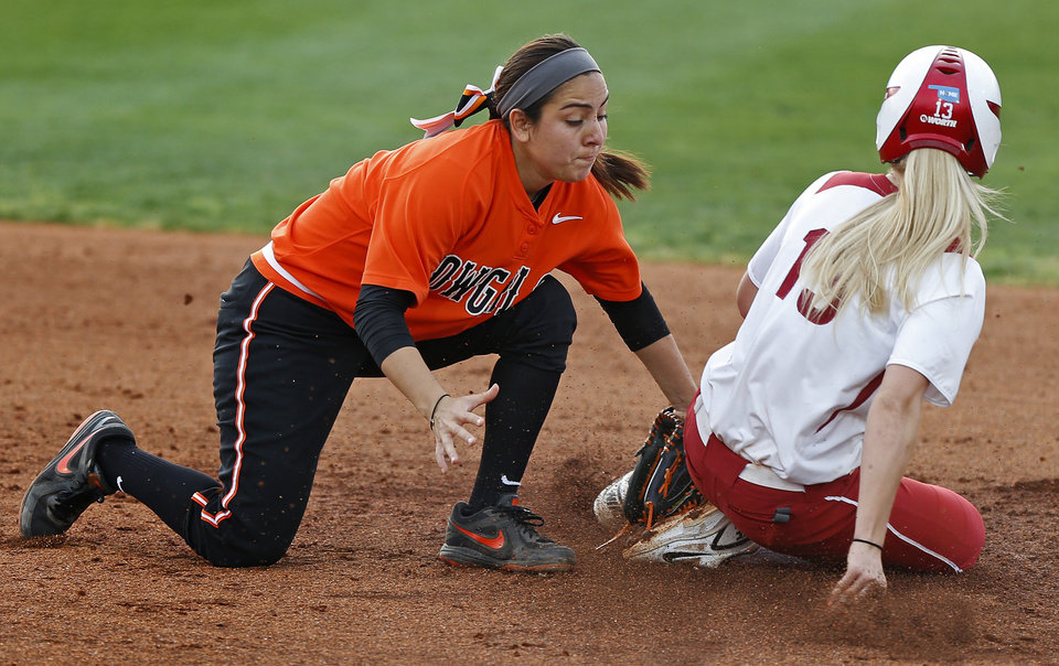 Photo - OSU's Michaela Patton tags out OU's Whitney Ellis at second base in the second inning of a Bedlam softball game between the University of Oklahoma and Oklahoma State University in Norman, Okla., Wednesday, April 2, 2014. Oklahoma won 2-0. Photo by Bryan Terry, The Oklahoman