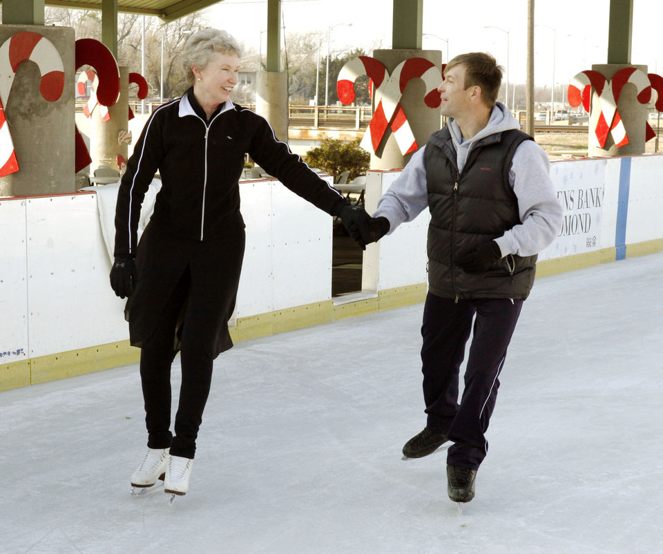 Dmitri Logoutine skates with Darlene Michael at the Edmond Outdoor Skating Rink in Edmond, OK, Friday, Dec. 9, 2011. He has gone from a Russian Ballet on Ice skater to becoming a U.S. citizen and owner of Ice Challenge Enterprises LLC. By Paul Hellstern, The Oklahoman