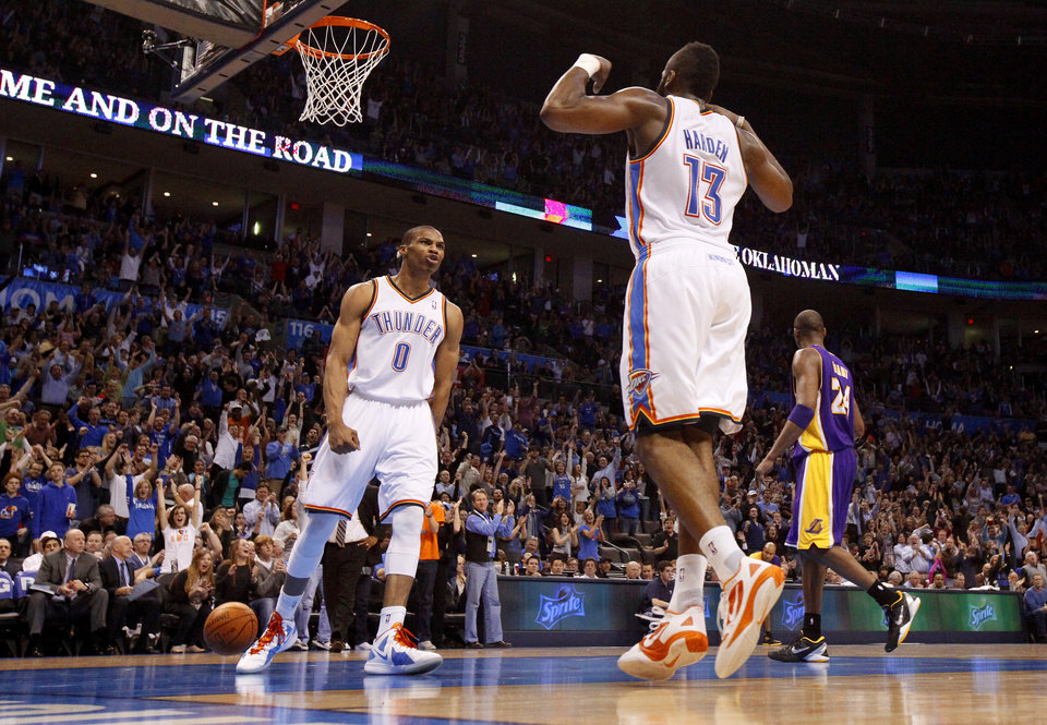 Photo - Oklahoma City's Russell Westbrook (0) and James Harden (13) celebrate during an NBA basketball game between the Oklahoma City Thunder and the Los Angeles Lakers at Chesapeake Energy Arena in Oklahoma City, Thursday, Feb. 23, 2012.  Oklahoma City won 100-85. Photo by Bryan Terry, The Oklahoman