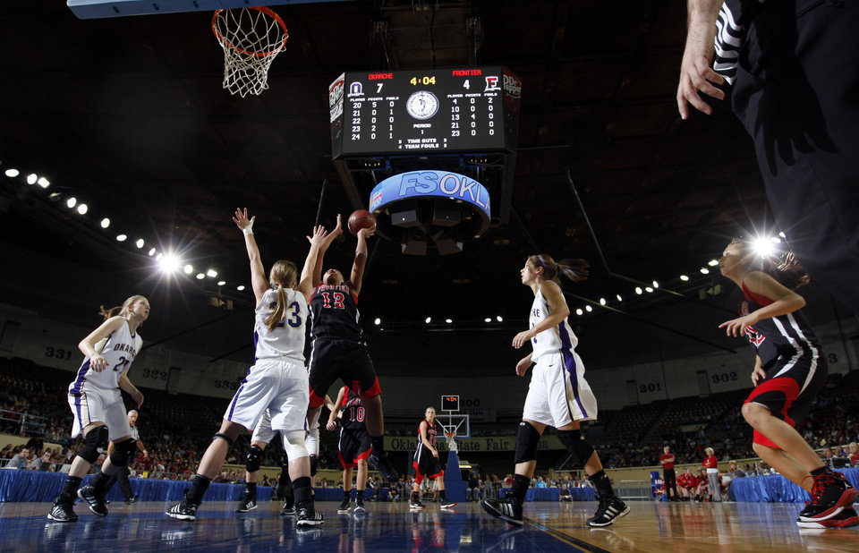Photo - Frontier's Marissa Goodman shoots over Okarche's Kinsey Grellner during Class A girls state championship high school basketball game between Okarche and Frontier  at the State Fair Arena in Oklahoma City,  Saturday, March 3, 2012. Photo by Sarah Phipps, The Oklahoman