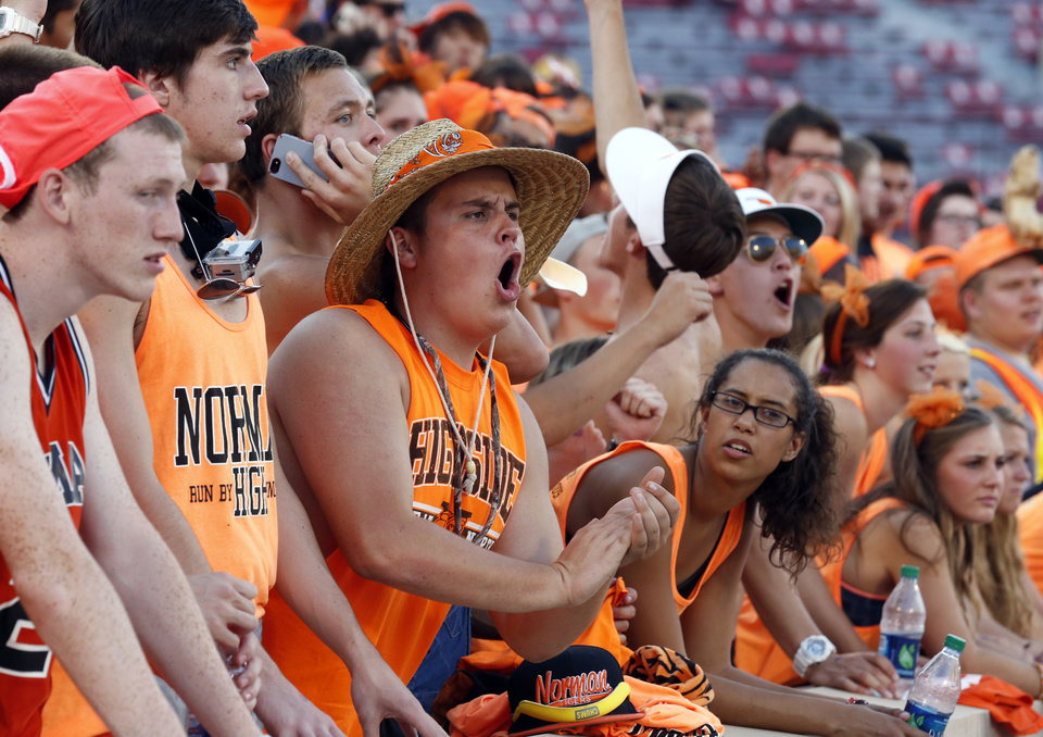 Photo - Norman High School fans cheer as their Tigers play Norman North Timberwolves at Gaylord Family-Oklahoma Memorial Stadium in Norman, Okla., on Thursday, Sept. 5, 2013. Photo by Steve Sisney, The Oklahoman