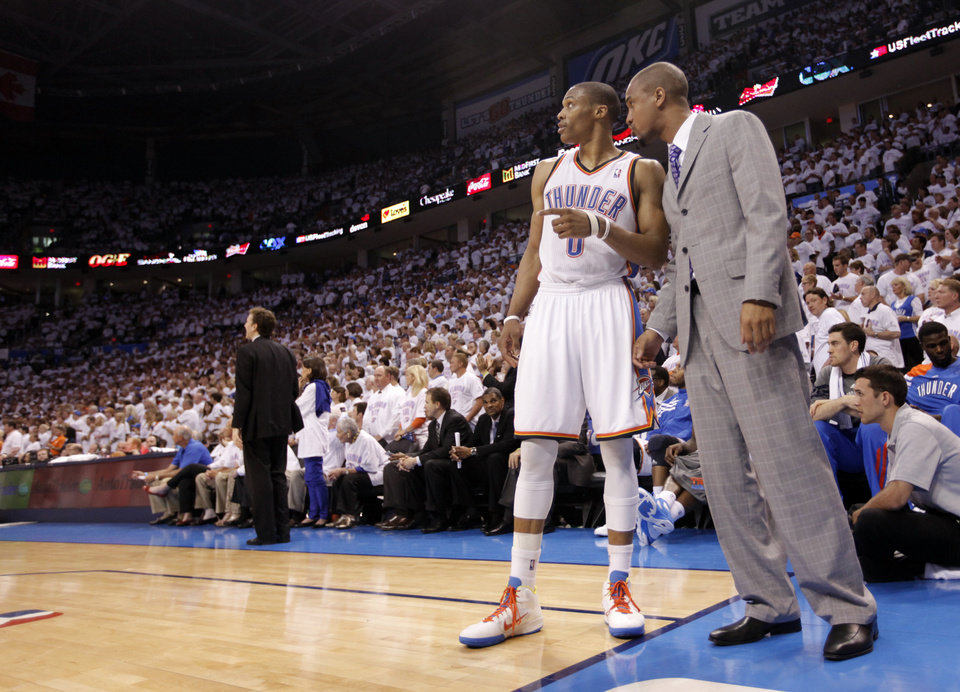 Russell Westbrook talks with Eric Maynor during Game 6 of the Western Conference Finals between the Oklahoma City Thunder and the San Antonio Spurs in the NBA playoffs at the Chesapeake Energy Arena in Oklahoma City, Wednesday, June 6, 2012. Photo by Chris Landsberger, The Oklahoman