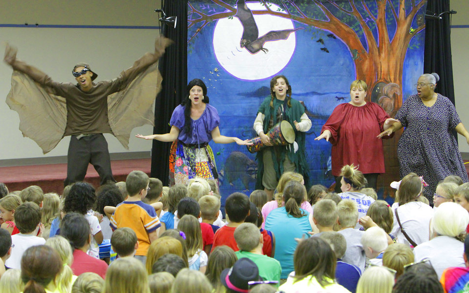 Photo - Right: From left, Chris Shepard, Amy Nevius, MacKenzie Mallen, Sandy Oliver and Trena Brown with Rhythmically Speaking sing a song at the Summer Reading Program presentation.