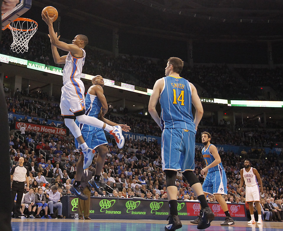 Photo - Oklahoma City Thunder point guard Russell Westbrook (0) drives to the basket past New Orleans Hornets point guard Jarrett Jack (2) during the NBA basketball game between the Oklahoma City Thunder and the New Orleans Hornets at the Chesapeake Energy Arena on Wednesday, Jan. 25, 2012, in Oklahoma City, Okla. Photo by Chris Landsberger, The Oklahoman