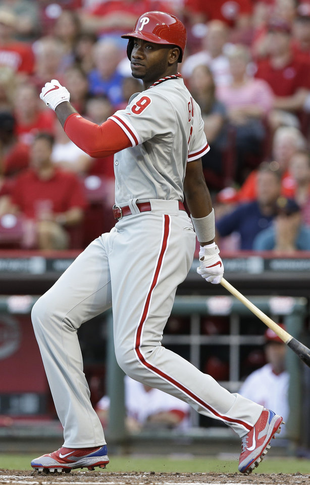 Photo - Philadelphia Phillies' Domonic Brown hits a double off Cincinnati Reds starting pitcher Johnny Cueto to drive in two runs in the fourth inning of a baseball game, Friday, June 6, 2014, in Cincinnati. (AP Photo/Al Behrman)