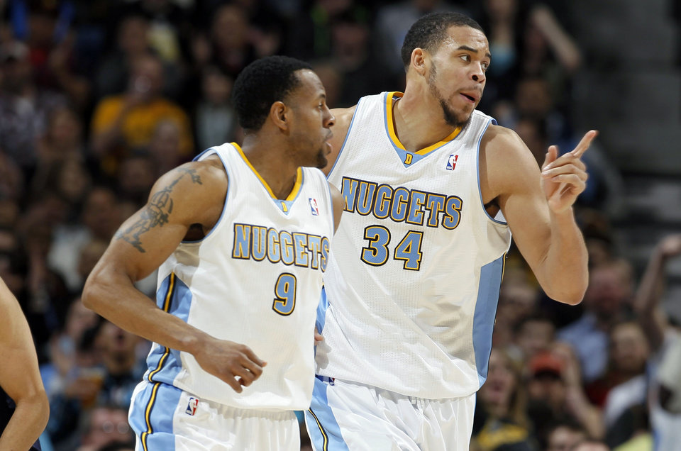 Denver Nuggets forward JaVale McGee, right, celebrates after his basket with guard Andre Iguodala against the Oklahoma City Thunder in the first quarter of an NBA basketball game in Denver on Friday, March 1, 2013. (AP Photo/David Zalubowski) ORG XMIT: CODZ106