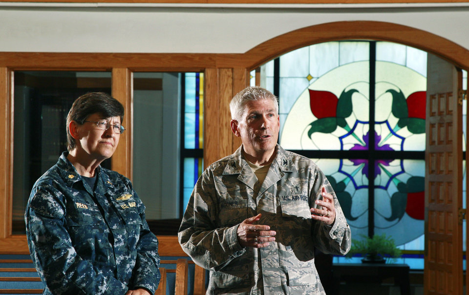 Photo -   ADVANCE FOR USE THURSDAY, JULY 5, 2012 AND THEREAFTER - In this Wednesday, June 27, 2012 photo, U.S. Navy Chaplain Kay Reeb, left, of the Evangelical Lutheran Church of America, stands with Air Force chaplain Col. Timothy Wagoner in the McGuire Air Force Base chapel at Joint Base McGuire-Dix-Lakehurst in Wrightstown, N.J. Wagoner, who commands five fellow chaplains, including Reeb, at the base in central New Jersey, has been an Air Force chaplain for 20 years, serving a denomination - the Southern Baptists - that officially frowns on same-sex relationships. Yet there he was, in late June, watching supportively as one of the airmen on his base celebrated a civil union ceremony, conducted by Reeb, with his male partner at the chapel that Wagoner oversees.