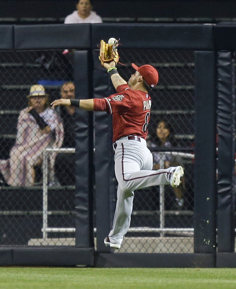 Photo - Arizona Diamondbacks center fielder Gerardo Parra can't make the catch on a double hit by San Diego Padres' Chase Headley that drives in a run in the first inning of a baseball game Wednesday, Sept. 25, 2013, in San Diego. (AP Photo/Lenny Ignelzi)