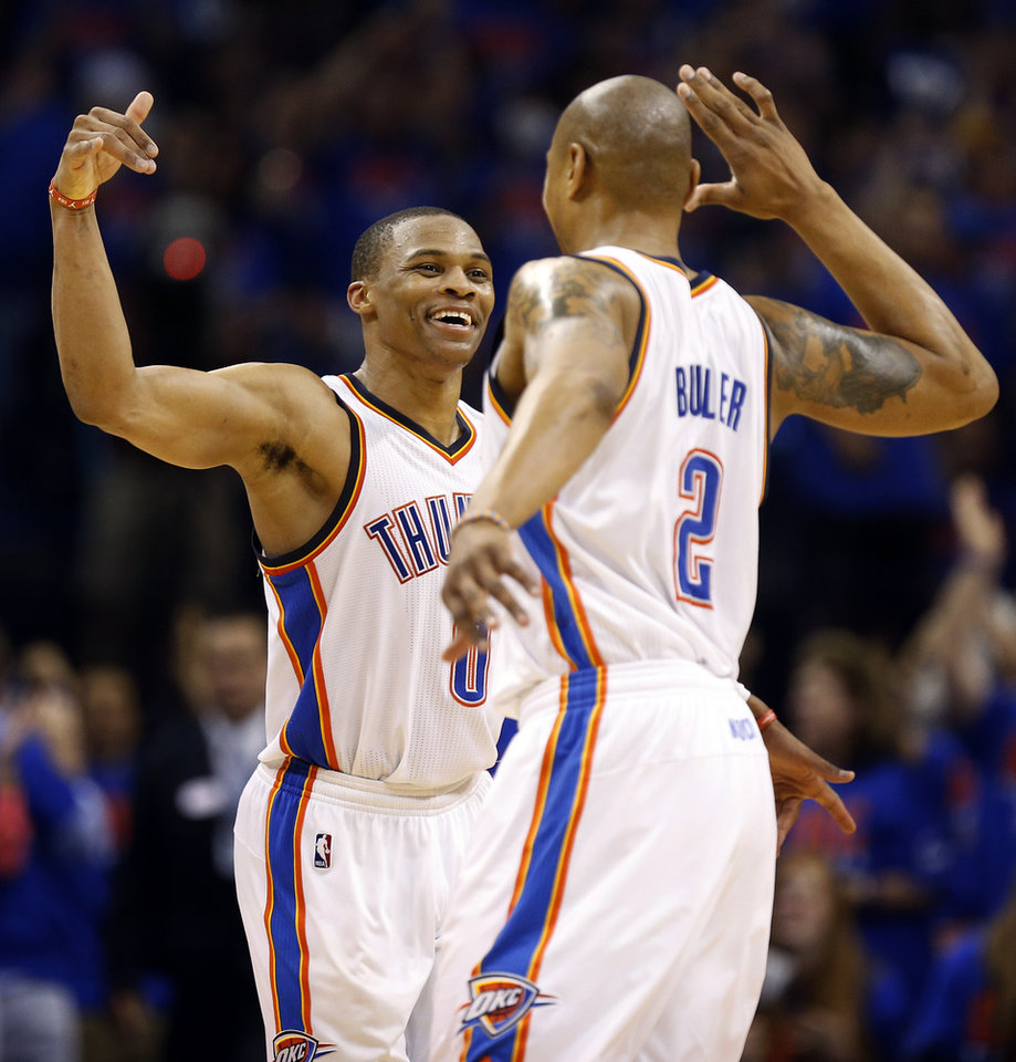 Photo - Oklahoma City's Russell Westbrook (0) celebrates with Caron Butler (2) during Game 7 in the first round of the NBA playoffs between the Oklahoma City Thunder and the Memphis Grizzlies at Chesapeake Energy Arena in Oklahoma City, Saturday, May 3, 2014. The Thunder won 120-109. Photo by Nate Billings, The Oklahoman