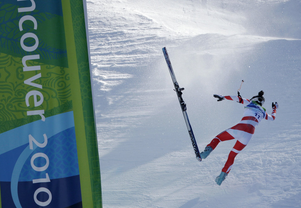 Photo - FILE - In this Feb. 17, 2010 file photo, Switzerland's Dominique Gisin crashes as she approaches the finish in the women's downhill at the Vancouver 2010 Olympics in Whistler, British Columbia. Gisin won her first major medal on Wednesday, Feb. 12, 2014, when she tied with Tina Maze of Slovenia to win the gold in the downhill at the 2014 Winter Olympics in Sochi, Russia. (AP Photo/Charlie Riedel, File)