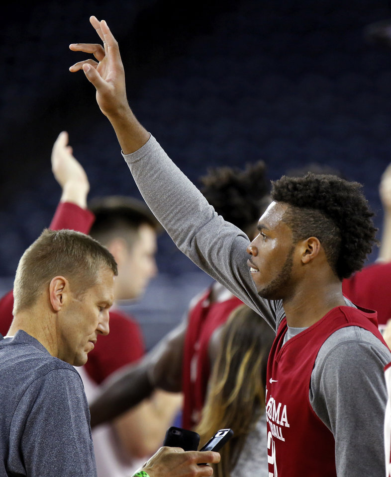 Photo - Oklahoma's Buddy Hield (24) waves to fans at the end of practice on Final Four Friday before the national semifinal between the Oklahoma Sooners and the Villanova Wildcats in the NCAA Men's Basketball Championship at NRG Stadium in Houston, Friday, April 1, 2016. OU will play Villanova in the Final Four on Saturday. Photo by Nate Billings, The Oklahoman