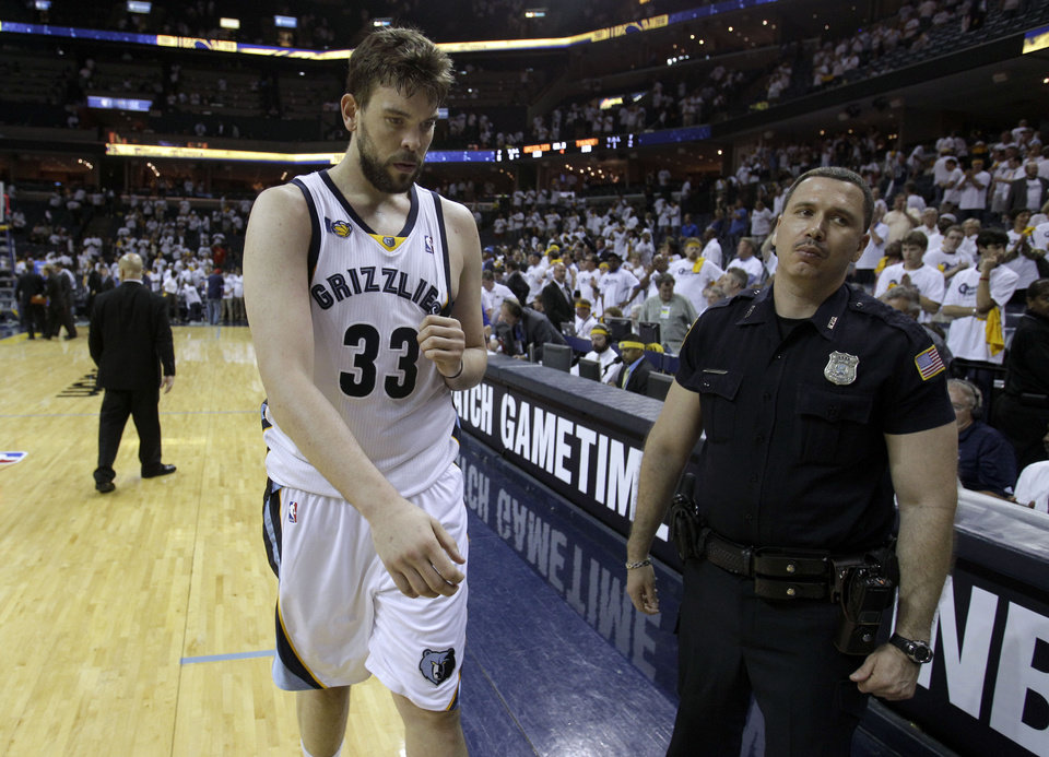 Photo - Memphis Grizzlies center Marc Gasol, of Spain, leaves the court following the Grizzlies' loss to the Oklahoma City Thunder in Game 4 of a second-round NBA basketball playoff series on Tuesday, May 10, 2011, in Memphis, Tenn. Oklahoma City won 133-123 in triple overtime. (AP Photo/Wade Payne)