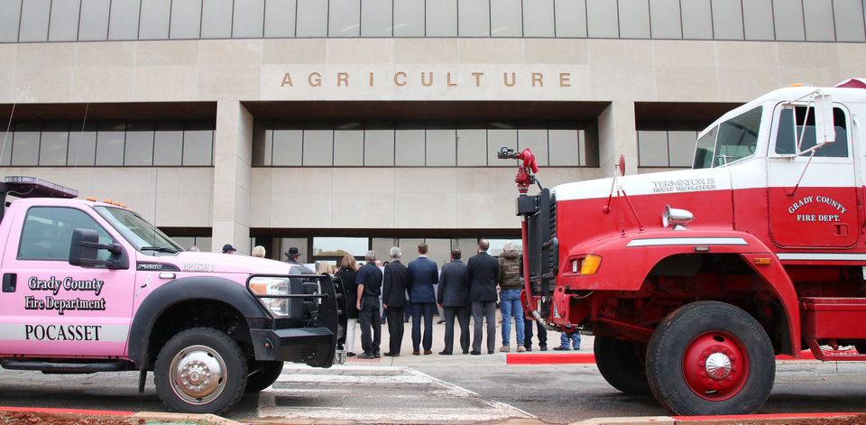 Photo -  Vehicles from volunteer fire departments in Grady County were brought to a ceremony Wednesday at the Oklahoma State Department of Agriculture, Food and Forestry to celebrate a $200,000 donation by Midship Pipeline to local fire departments.