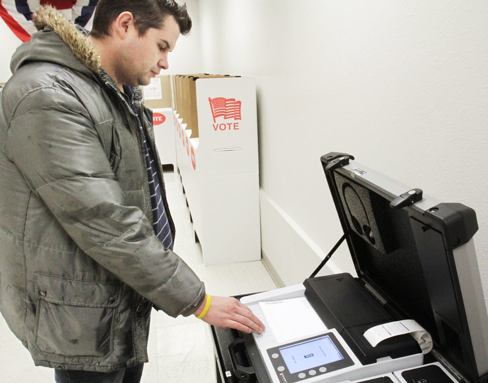 Colin Raley votes early at the County Election Board on Monday,  February 13, 2012.   Photo by David McDaniel, The Oklahoman