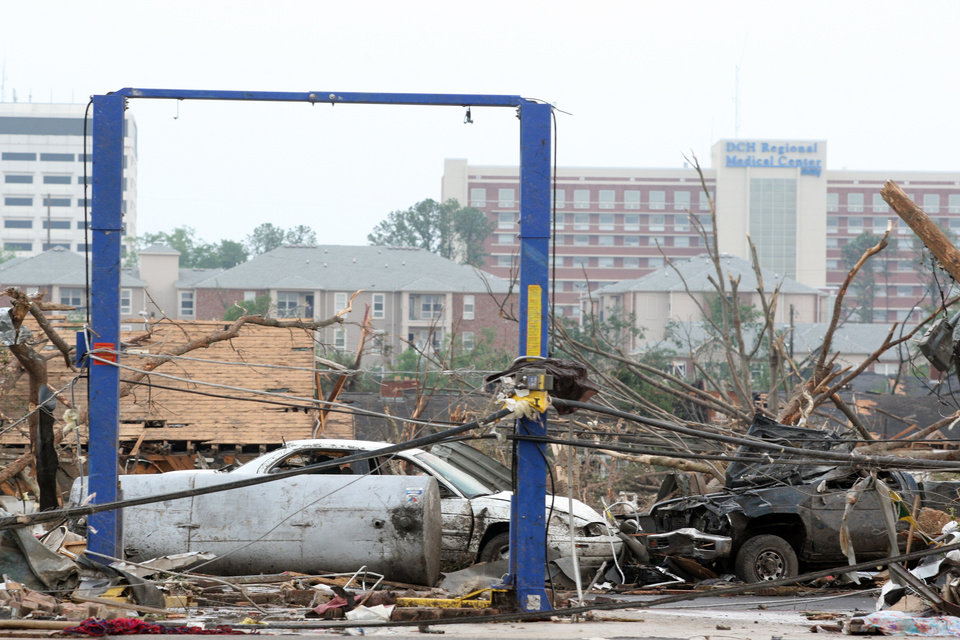 Photo - Debris is littered after a tornado hit, Wednesday, April 27, 2011 Tuscaloosa, Ala. A wave of severe storms laced with tornadoes strafed the South on Wednesday, killing at least 16 people around the region and splintering buildings across swaths of an Alabama university town. (AP Photo/Caroline Summers)