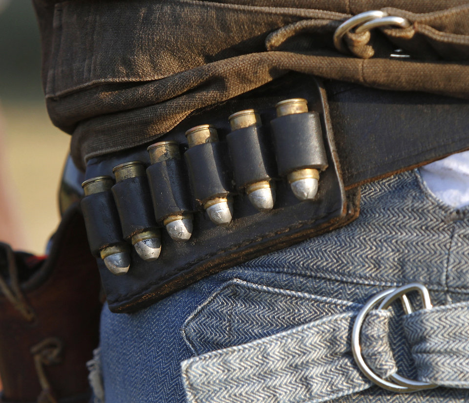 Photo - A gun belt worn by a cowboy who performs in the Pawnee Bill Wild West Show in Pawnee, Oklahoma on Saturday,  June 23, 2012.  Photo by Jim Beckel, The Oklahoman