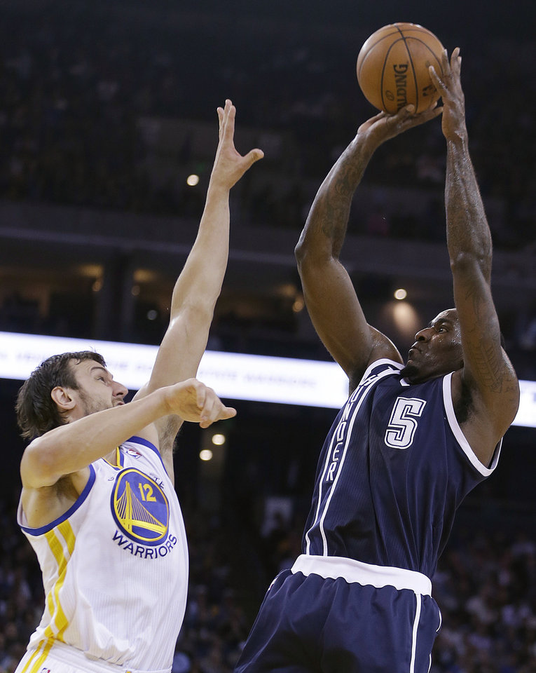 Oklahoma Thunder center Kendrick Perkins, right, shoots over Golden State Warriors' Andrew Bogut during the first half of an NBA basketball game Thursday, April 11, 2013, in Oakland, Calif. (AP Photo/Ben Margot)