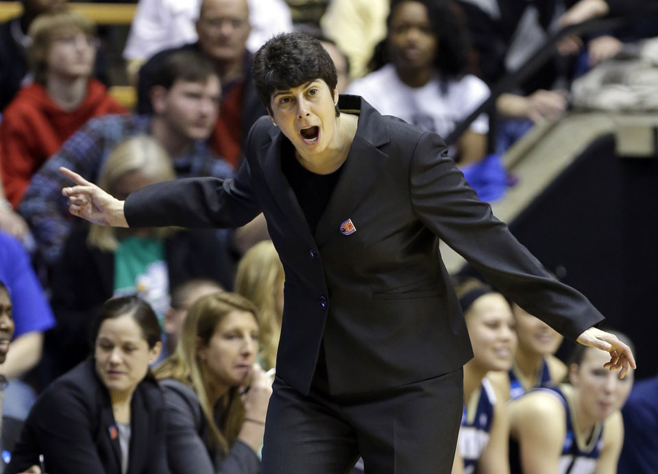Photo - Akron head coach Jodi Kest yells to her team as they played against Purdue during the second half of a first-round game in the NCAA women's college basketball tournament in West Lafayette, Ind., Saturday, March 22, 2014. Purdue defeated Akron 84-55. (AP Photo/Michael Conroy)