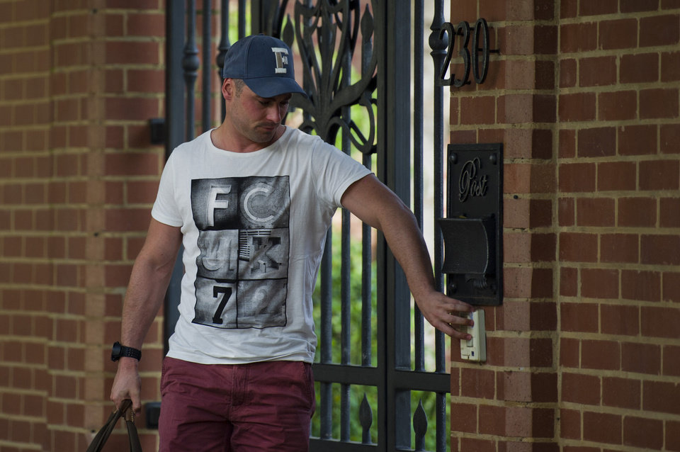 Carl Pistorius, brother of Olympian athlete, Oscar Pistorius, arrives at home, Sunday Feb. 24, 2013, where his brother has been staying in Pretoria, South Africa, since being granted bail Friday for the Valentine\'s Day shooting death of his girlfriend, Reeva Steenkamp. Reports emerged Sunday that Carl Pistorius is facing charges of culpable homicide for the death of a woman biker who was knocked down in 2010. (AP Photo)