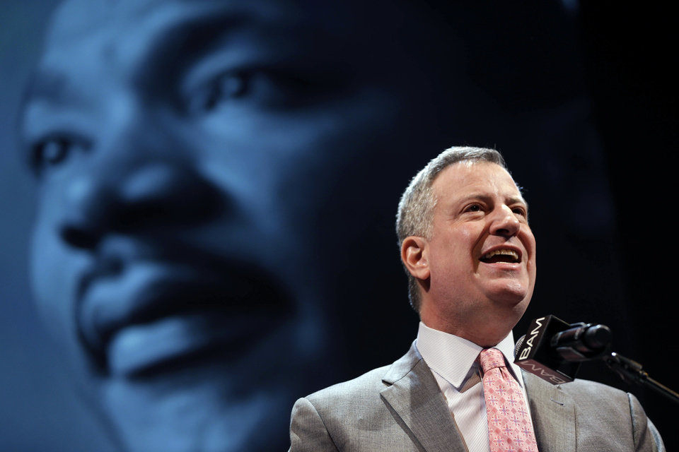 Photo - New York City Mayor Bill de Blasio speaks at a tribute to Martin Luther King, Jr. in the Brooklyn borough of New York, Monday, Jan. 20, 2014. De Blasio told a packed audience Monday at the Brooklyn Academy of Music that the