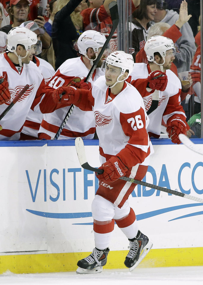 Photo - Detroit Red Wings right wing Tomas Jurco (26) celebrates with the bench aftar scoring against the Tampa Bay Lightning during the second period of an NHL hockey game, Saturday, Feb. 8, 2014, in Tampa, Fla. (AP Photo/Chris O'Meara)