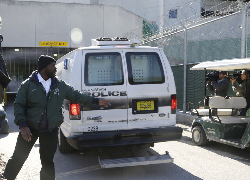 Photo - A prisoner transport van believed to be carrying pop star Justin Bieber arrives at the Turner Guilford Knight Correctional Center, Thursday, Jan. 13, 2014, in Miami. Bieber and R&B singer known as Khalil were arrested early Thursday for allegedly drag racing on a Miami Beach Street. Police say Bieber failed a field sobriety test. (AP Photo/Lynne Sladky)