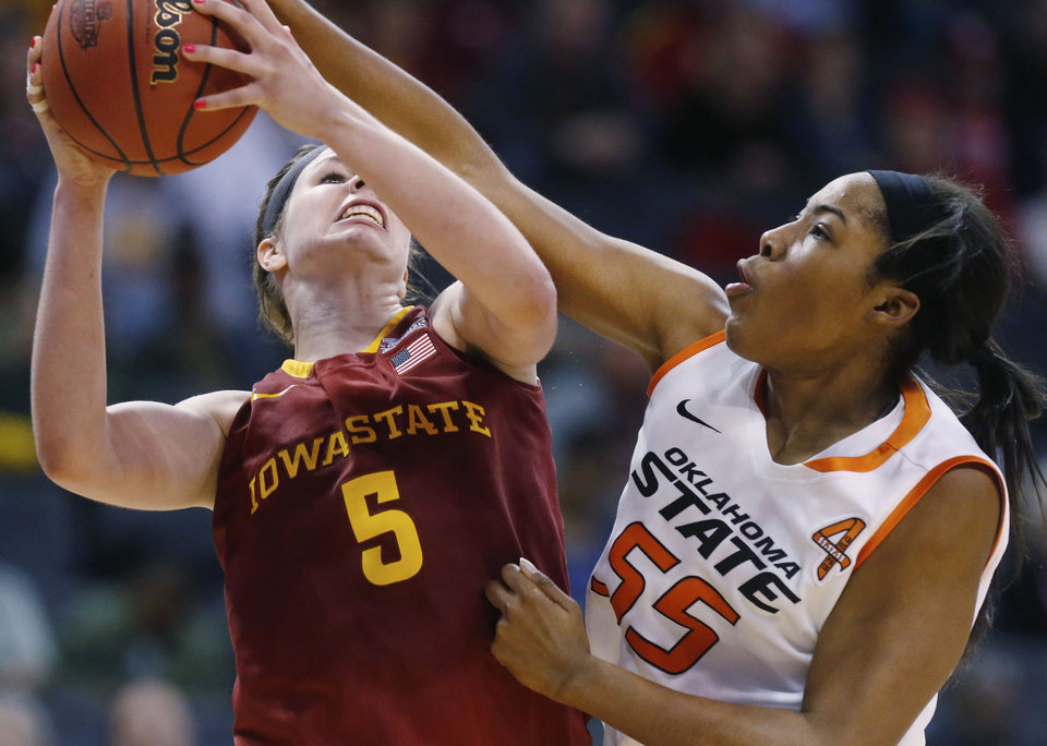 Photo - Iowa State forward Hallie Christofferson (5) is fouled by Oklahoma State center LaShawn Jones (55) as she shoots in the second half of an NCAA college basketball game in the quarterfinals of the Big 12 Conference women's college tournament in Oklahoma City, Saturday, March 8, 2014. Oklahoma State won 67-57. (AP Photo/Sue Ogrocki)